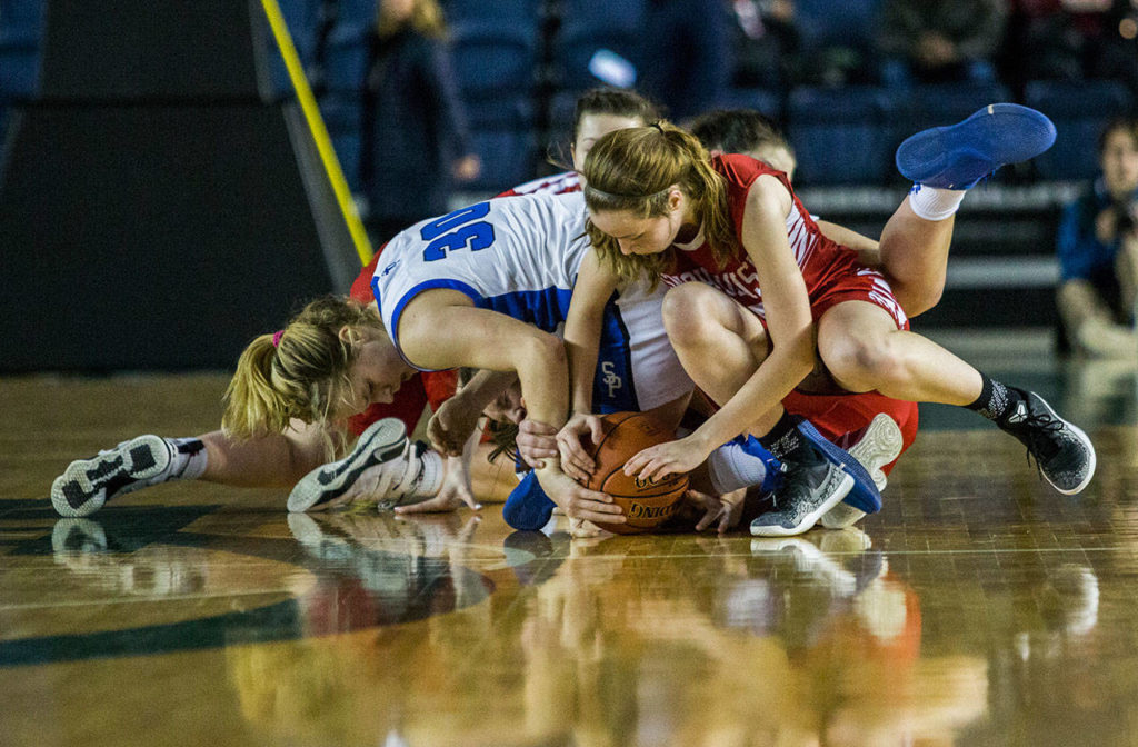 Snohomish and Seattle Prep players scramble for the ball during the game against Seattle Prep at the 3A Girls Hardwood Classic on Wednesday, Feb. 27, 2019 in Tacoma, Wash. (Olivia Vanni / The Herald)