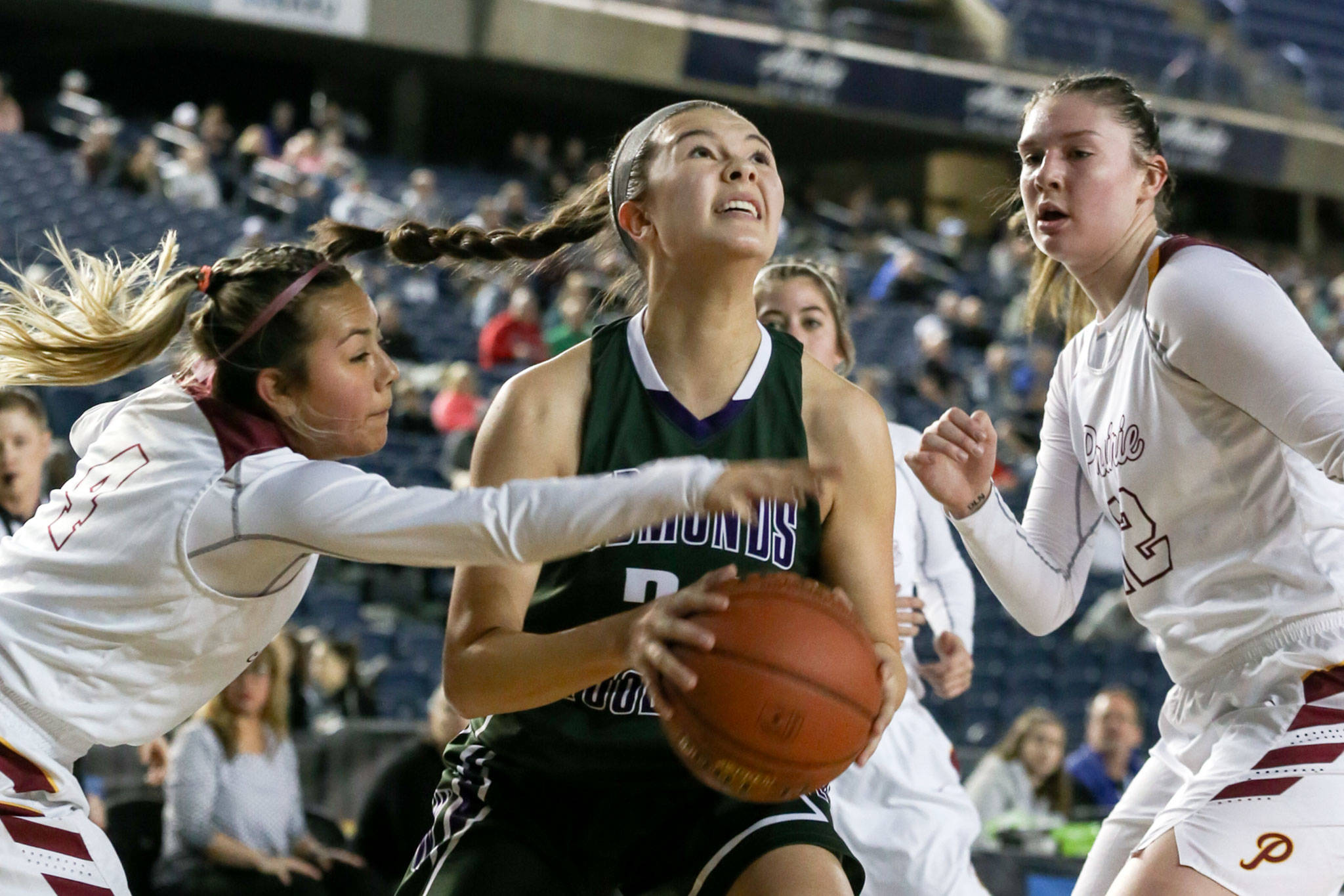 Edmonds-Woodway's Rebekah Dasalla drives the baseline with Prairie's Allison Corral reaching in with Haley Reed looking on Thursday morning at the Tacoma Dome on February 28, 2019. The Warriors lost 58-39.(Kevin Clark / The Herald)