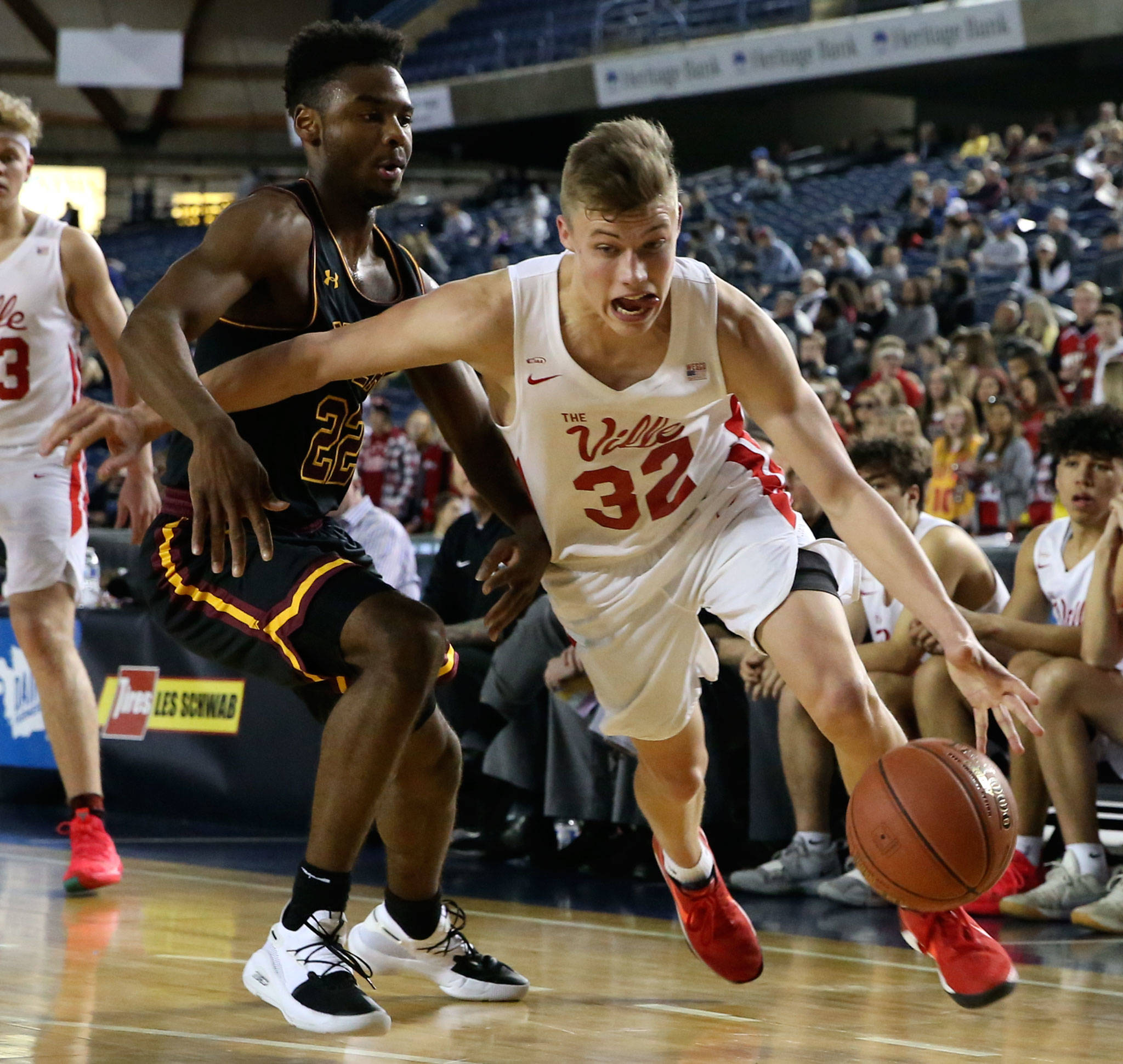 Marysville-Pilchuck's Aaron Kalab drives the baseline with O'Dea Jermaine Davis trailing Thursday afternoon at the Tacoma Dome on February 28, 2019. The Tomahawks lost 63-53. (Kevin Clark / The Herald)