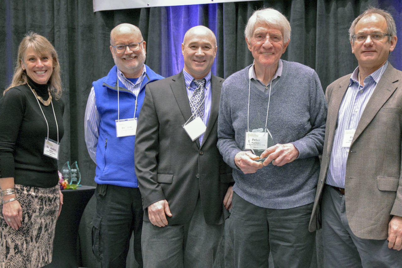 Peter Hallson (second from right) of Edmonds Bicycle Advocacy Group accepts the Outstanding Community Advocate Award from (left to right) Verdant Superintendent Dr. Robin Fenn, Commissioner Dr. Jim Distelhorst, Commissioner Fred Langer, and Commissioner Bob Knowles at the Verdant Healthier Community Conference.