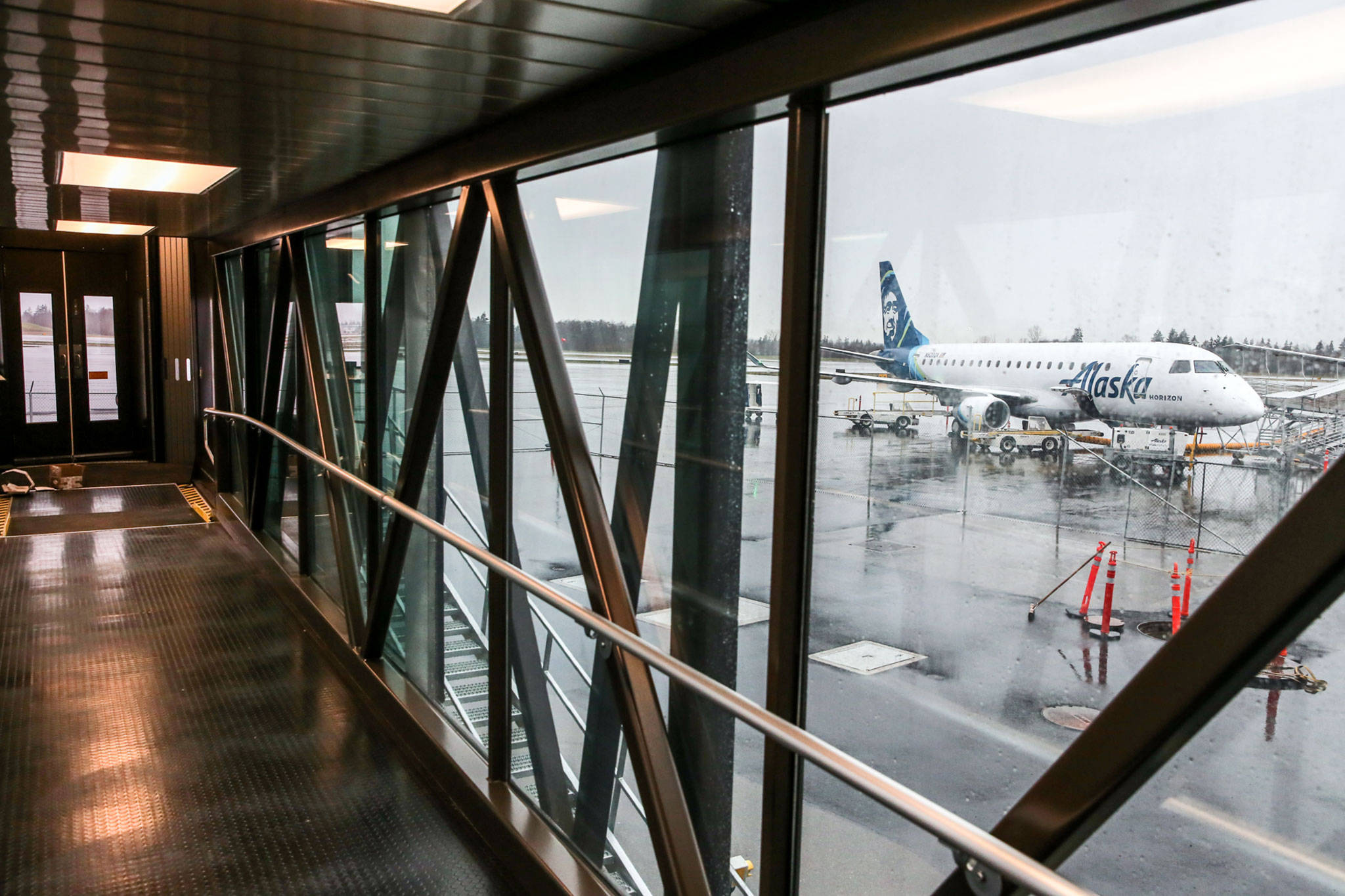 An aircraft seen from the gangway at the new airport at Paine Field in Everett on Jan. 9. (Kevin Clark / Herald file)