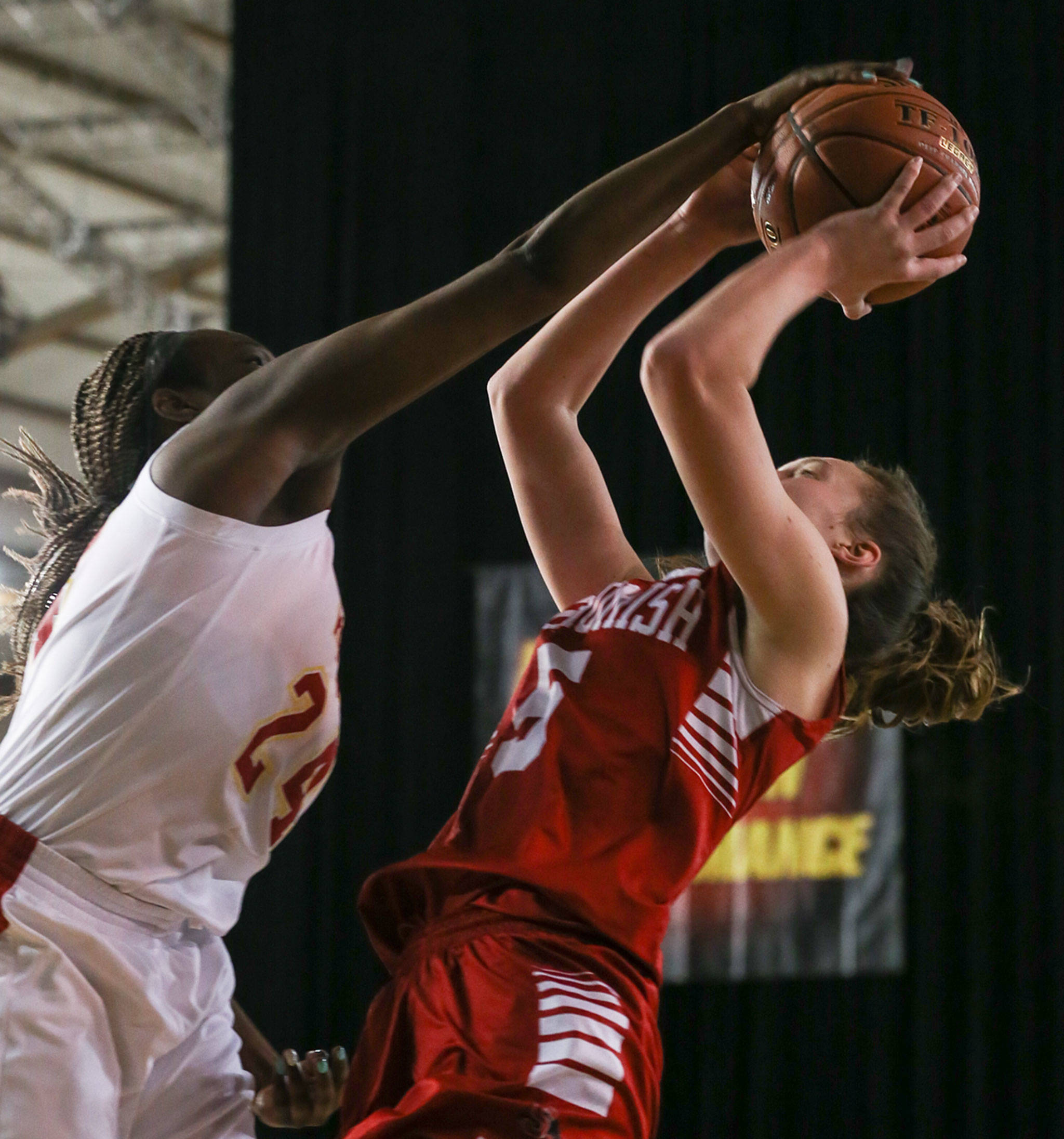 Kamiakin's Oumou Toure blocks Snohomish's Ella Gallatin at the Tacoma Dome on Feb. 28. The Panthers lost 57-39. (Kevin Clark / The Herald)