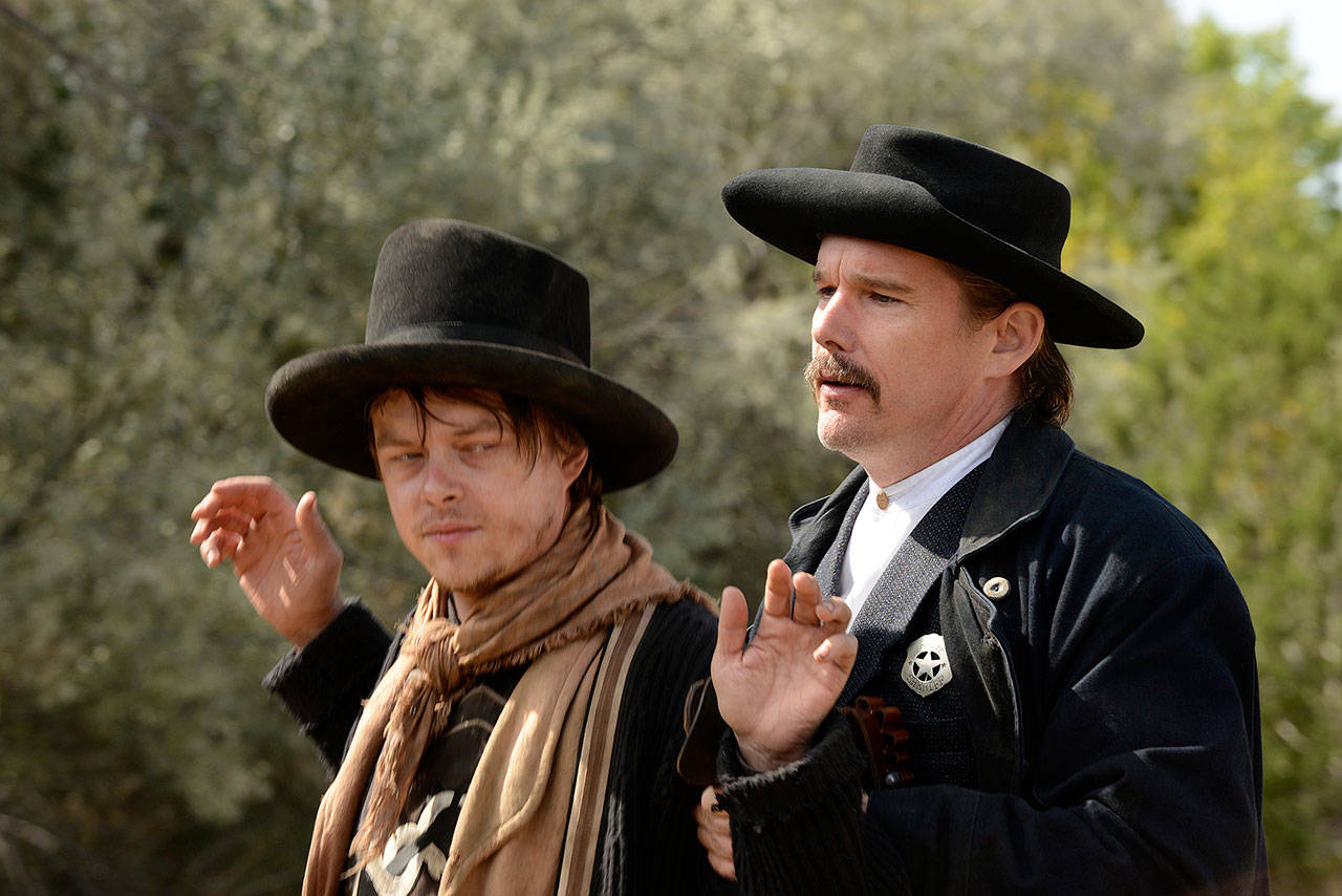"Dane DeHaan (left) plays Billy the Kid and and Ethan Hawke portrays Pat Garrett in ""The Kid."" (Lionsgate)"