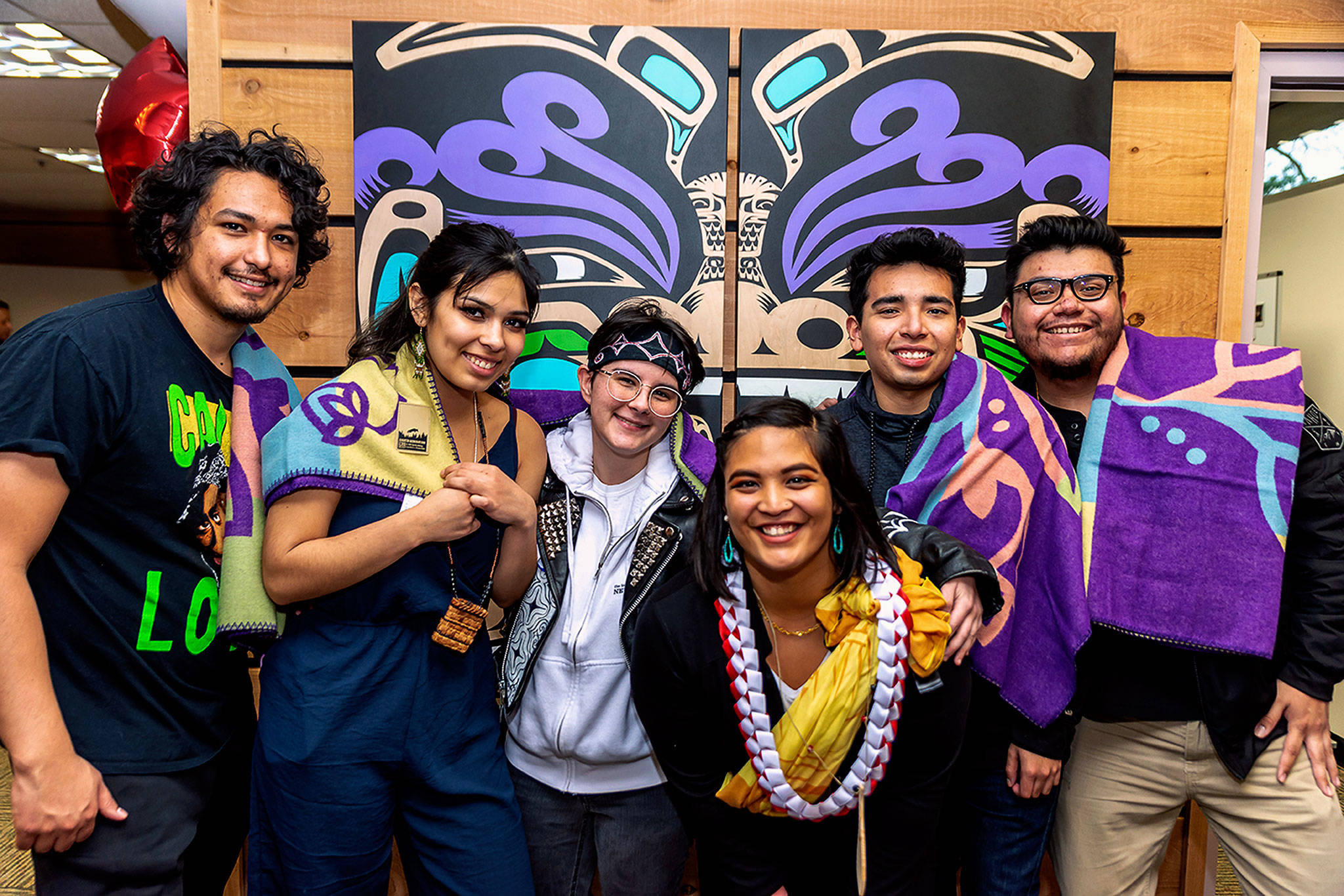 With Emma Ka'aha'aina (fourth from left in lei), program manager of EvCC's Diversity & Equity Center, are members of the college's First Nations Club who proposed a space for Native American, Indigenous and Pacific Islander students. They are, from left, Cullen Zackuse, Kayah George, Tara Duffin, Sebastian Corrales and Rafael Alverez. (Photo by Derek Walker, EvCC)