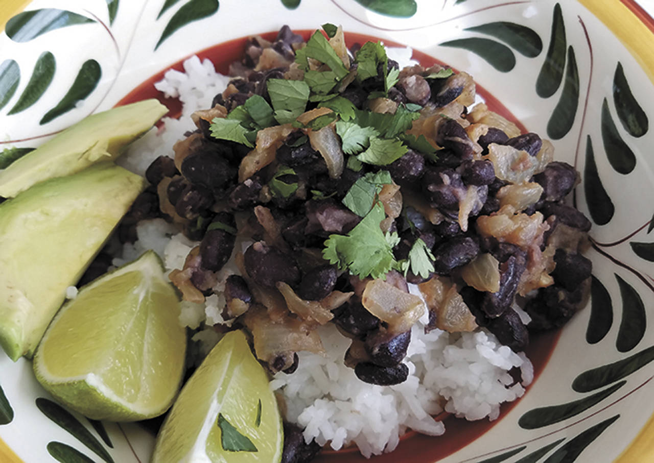 "This ""no-recipe-recipe"" for rice and beans is made with orange juice, fresh cilantro and ground cumin. (Sharon Salyer/The Herald)"