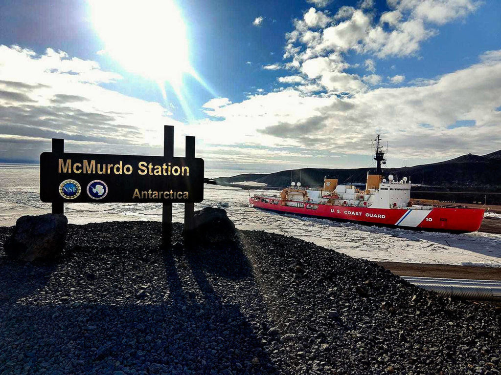 The U.S. Coast Guard's Polar Star, a heavy icebreaker, at McMurdo Station in Antarctica during its recent 105-day deployment. (Photo Courtesy U.S. Coast Guard)