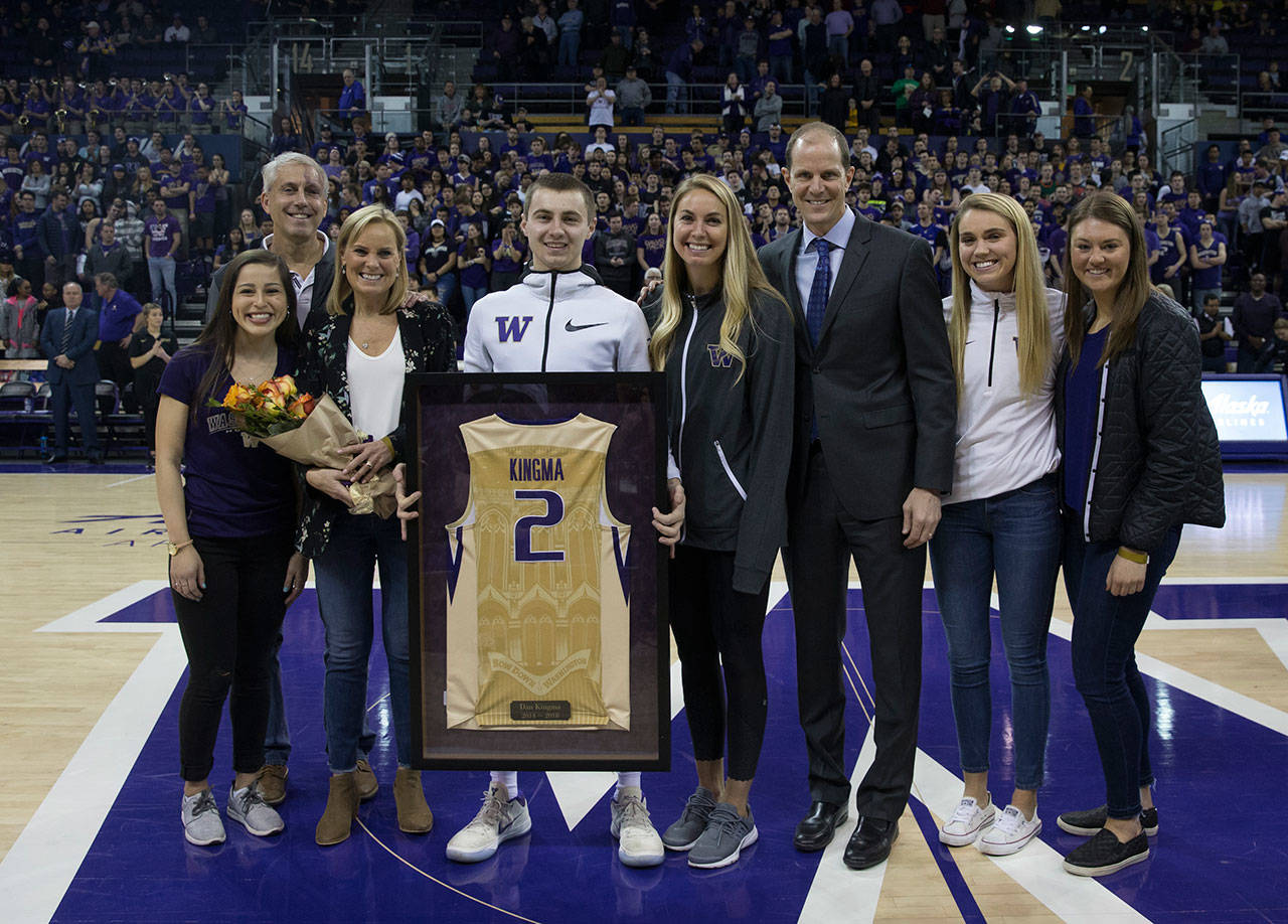 Dan Kingma (center), a Jackson High School alum, celebrates with his family and University of Washington men's basketball coach Mike Hopkins (third from right) during Senior Day festivities on March 3, 2018, at Alaska Airlines Arena in Seattle. (UW Athletics photo)