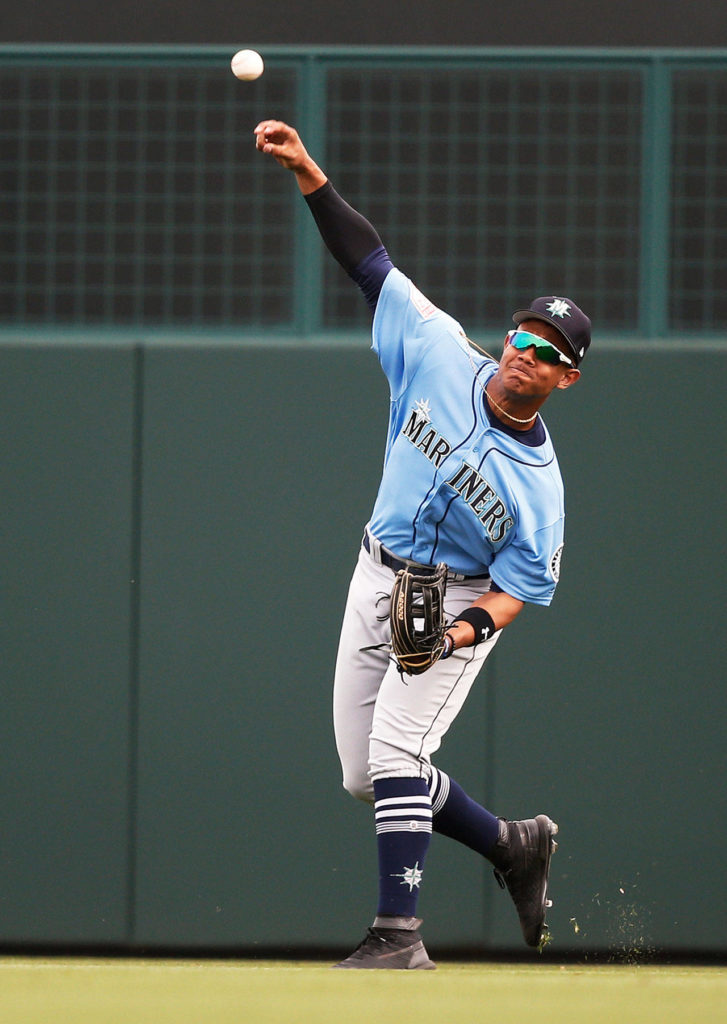 The Mariners' Julio Rodriguez throws the ball in from the outfield during a spring game against the Dodgers on March 9, 2019, in Phoenix. (AP Photo/Sue Ogrocki)