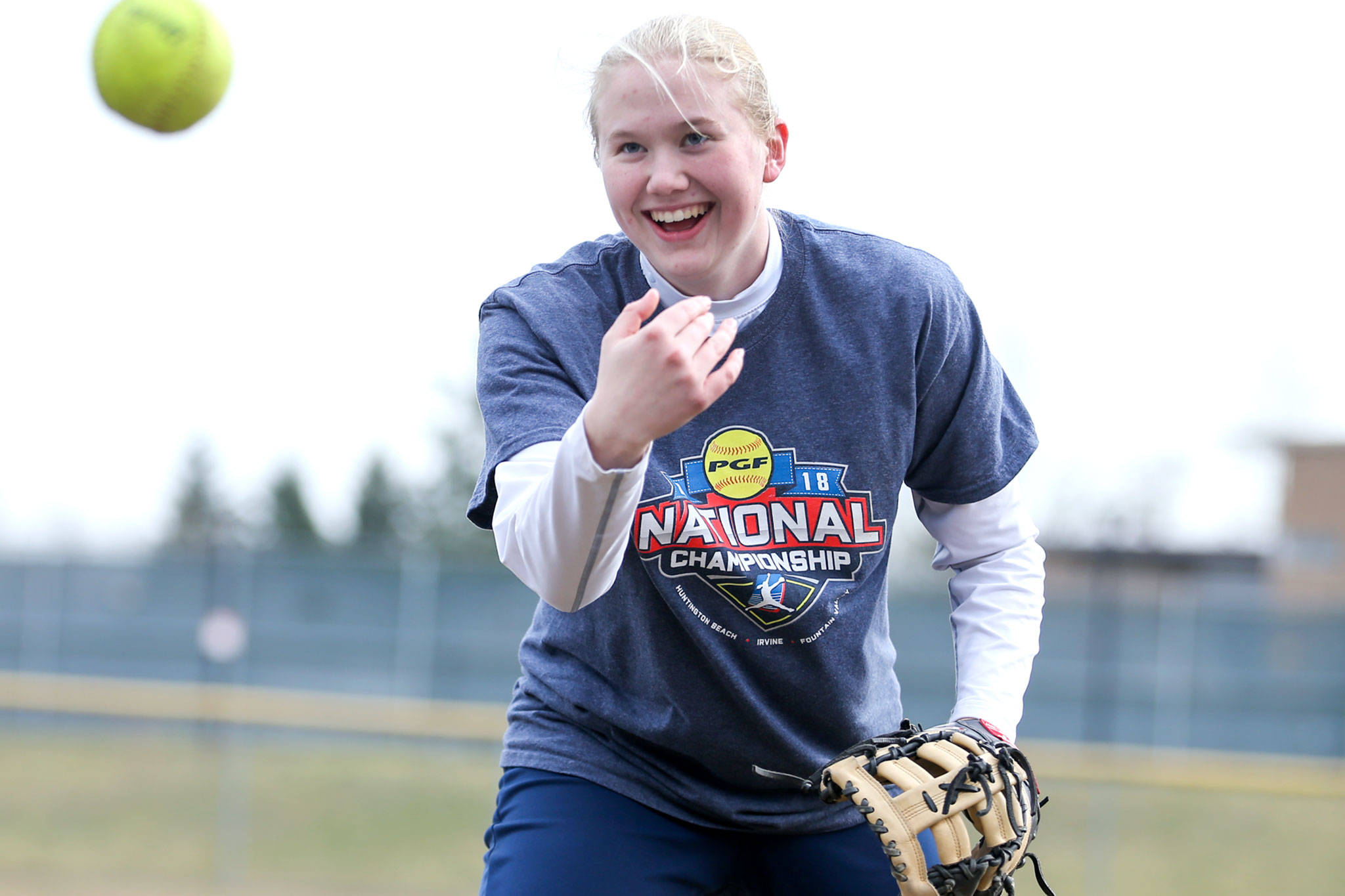 First baseman Ashley Jacobson, who has committed to play Division I softball at Stony Brook in New York, shares a laugh during practice. (Kevin Clark / The Herald)