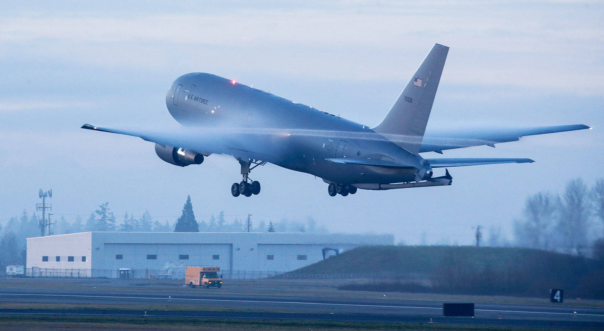 Condensation forms off the wings of a Boeing KC-46 Pegasus tanker taking off from Paine Field in Everett on Jan. 25. The U.S. Air Force has grown alarmed with the amount of trash, tools and other items that were being left behind in new KC-46 tanker planes the company was delivering. (Andy Bronson / The Herald)