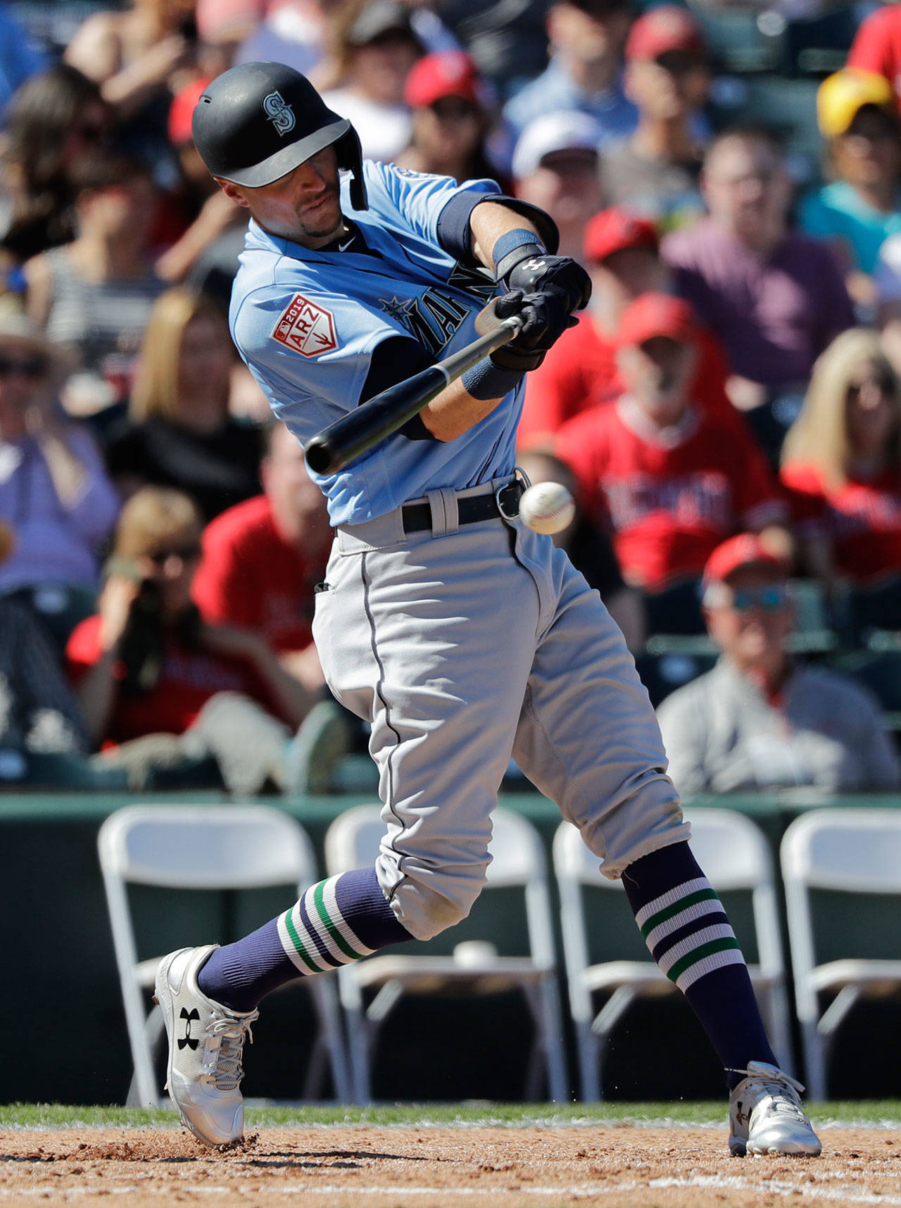 Mariners outfielder Braden Bishop bats during a spring game against the Angels on March 10, 2019, in Tempe, Ariz. (AP Photo/Elaine Thompson)