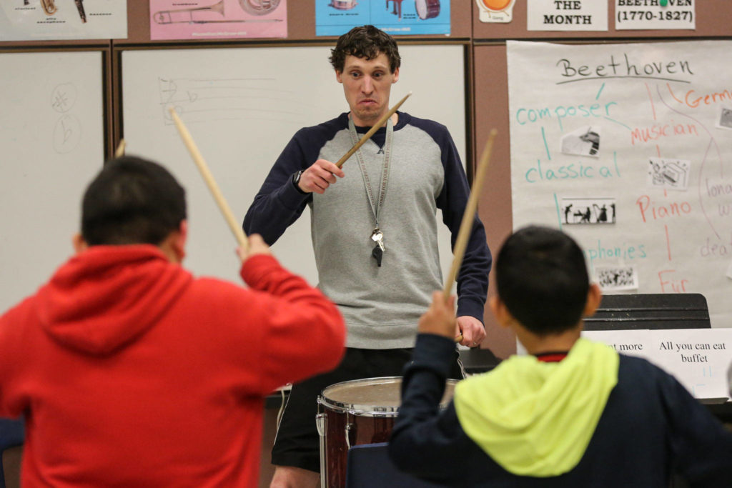 Pat Jameson leads the drum circle during practice at Challenger Elementary in Everett on March 6, 2019. (Kevin Clark / The Herald)