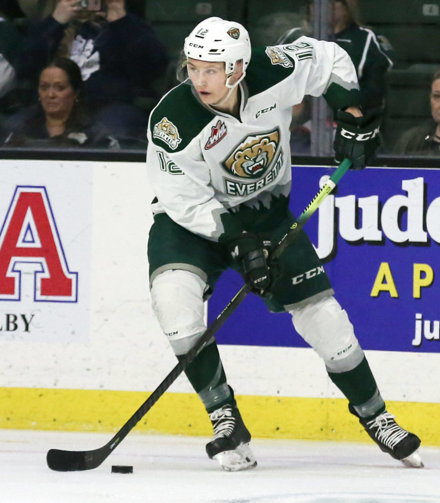 The Silvertips' Max Patterson controls the puck during Game 2 of a first-round playoff series against Tri-City on March 23, 2019, at Angel of the Winds Arena in Everett. (Kevin Clark / The Herald)