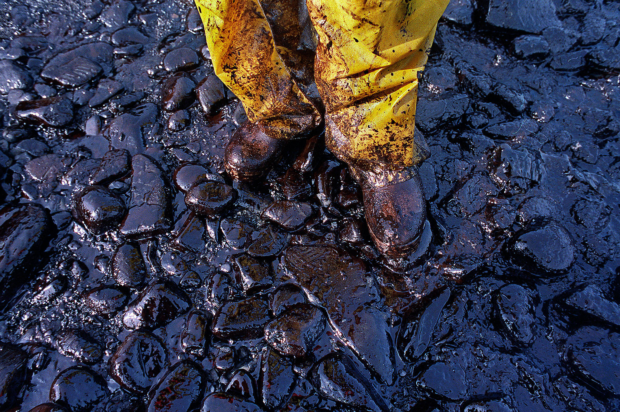 The Exxon Valdez oil tanker spill March 24, 1989, blackened hundreds of miles of coastline in Alaska's Prince William Sound, devasting wildlife and altering lives in fishing communities for generations. (John Gaps III / Associated Press)