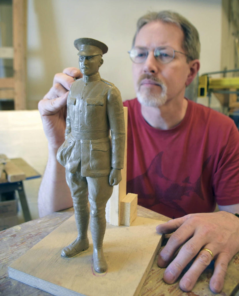 Dillon Works employee John Douglass sculpts the Topliff Paine maquette in clay, the first step in creating the full-sized sculpture at Everett's Paine Field. (Dillon Works)