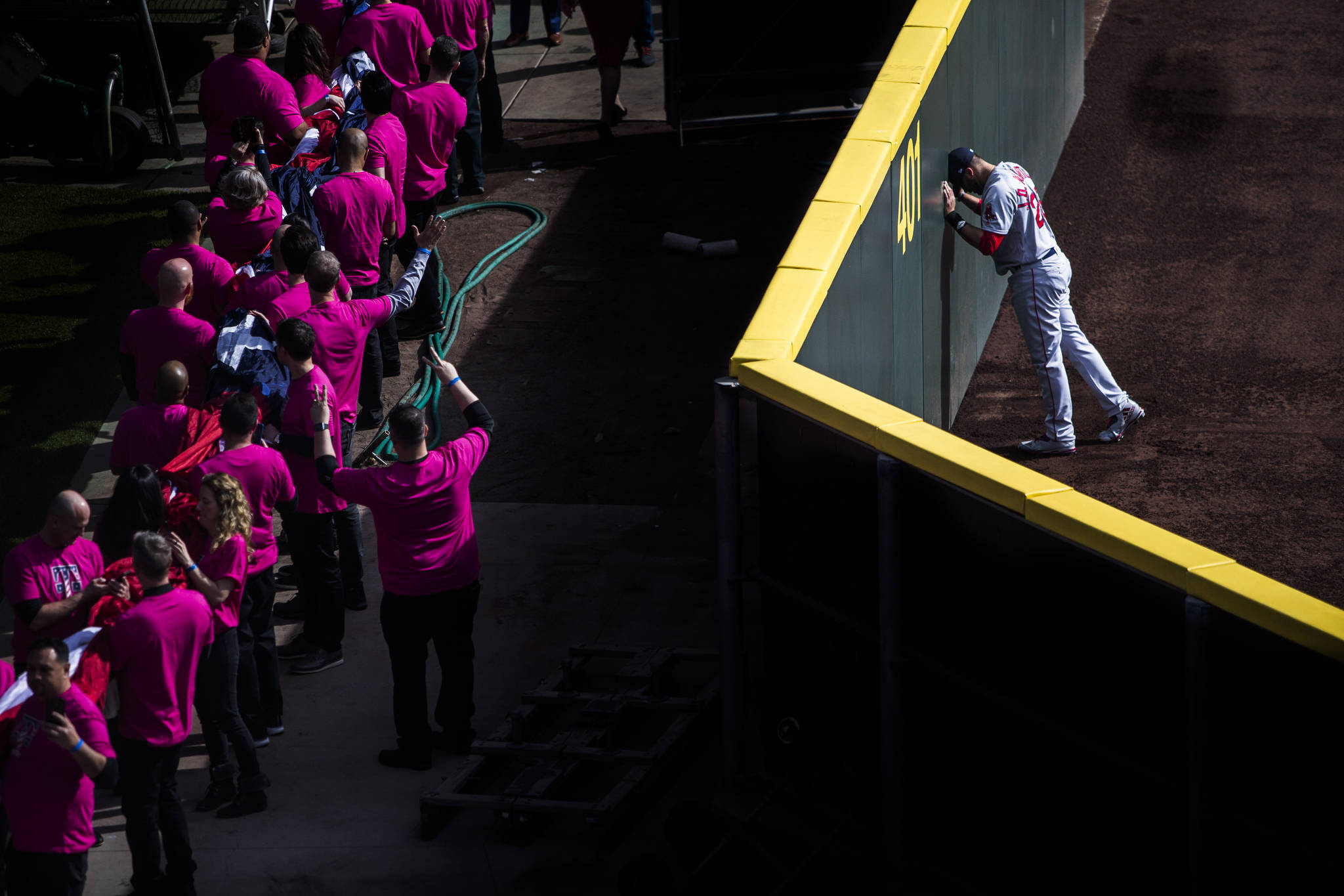 Boston Red Sox's J.D. Martinez says a prayer in the outfield before the start of the game during Opening Day at T-Mobile Park on Thursday, March 28, 2019 in Seattle, Wash. (Olivia Vanni / The Herald)