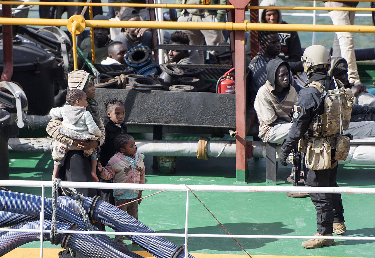 A Maltese special operations team boarded a tanker on Thursday that had been hijacked by migrants rescued at sea, and returned control to the captain, before escorting it to a Maltese port. (AP Photo/Rene' Rossignaud)