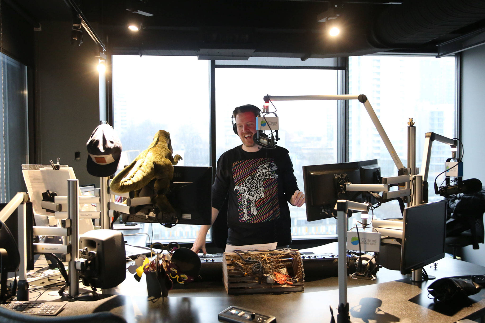 Gregr records segments in the 107.7 The End studio in Seattle. He moved with his family to a home in Snohomish. (Kevin Clark / The Herald)