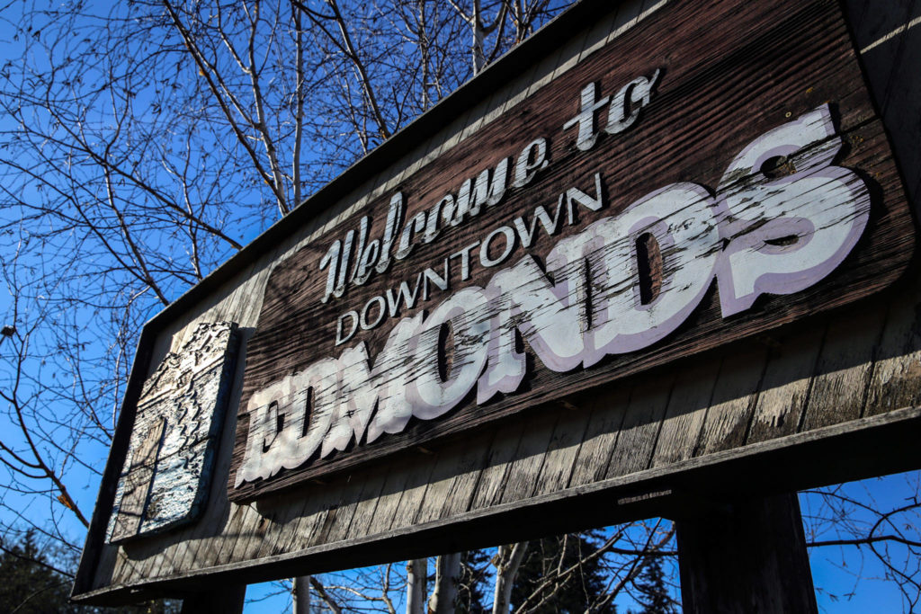 The old Edmonds sign that has stood for more than 40 years is faded and peeling. Proposals are in the works to replace it. (Kevin Clark / The Herald)