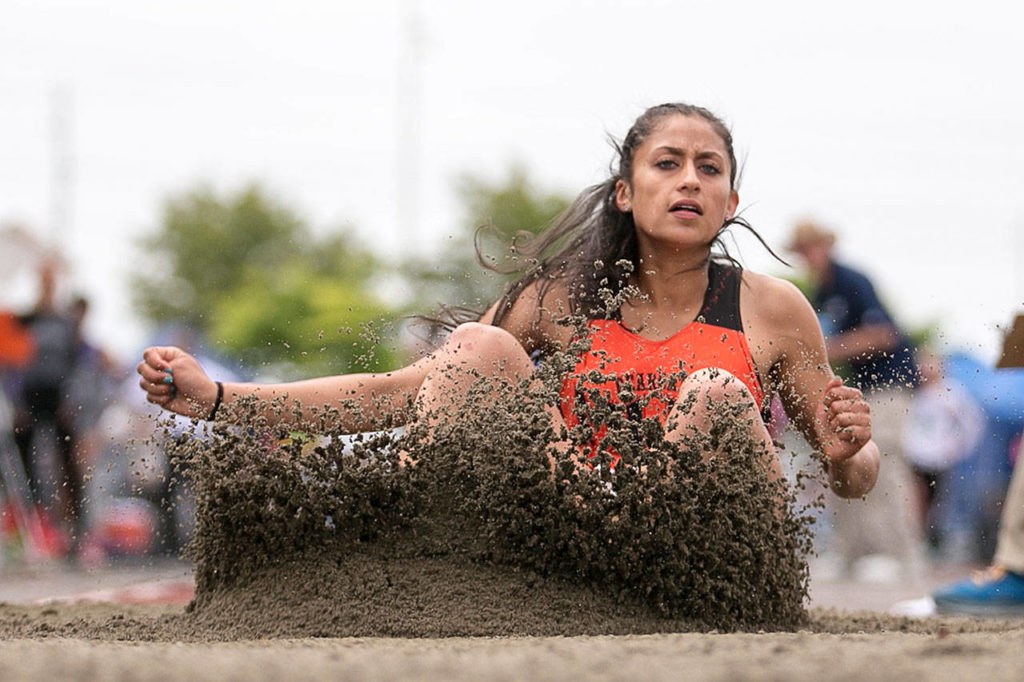 As a freshman last season, Monroe's Hannah Ganashamoorthy posted a mark of 20 feet, 2 inches in the long jump, which ranked 16th in the nation. (Kevin Clark / The Herald)