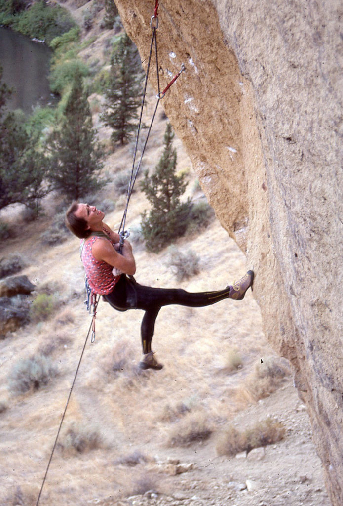 Alan Watts hangdogs while climbing the Rude Boys route at Smith Rock in Oregon in 1985. (Jeff Smoot)