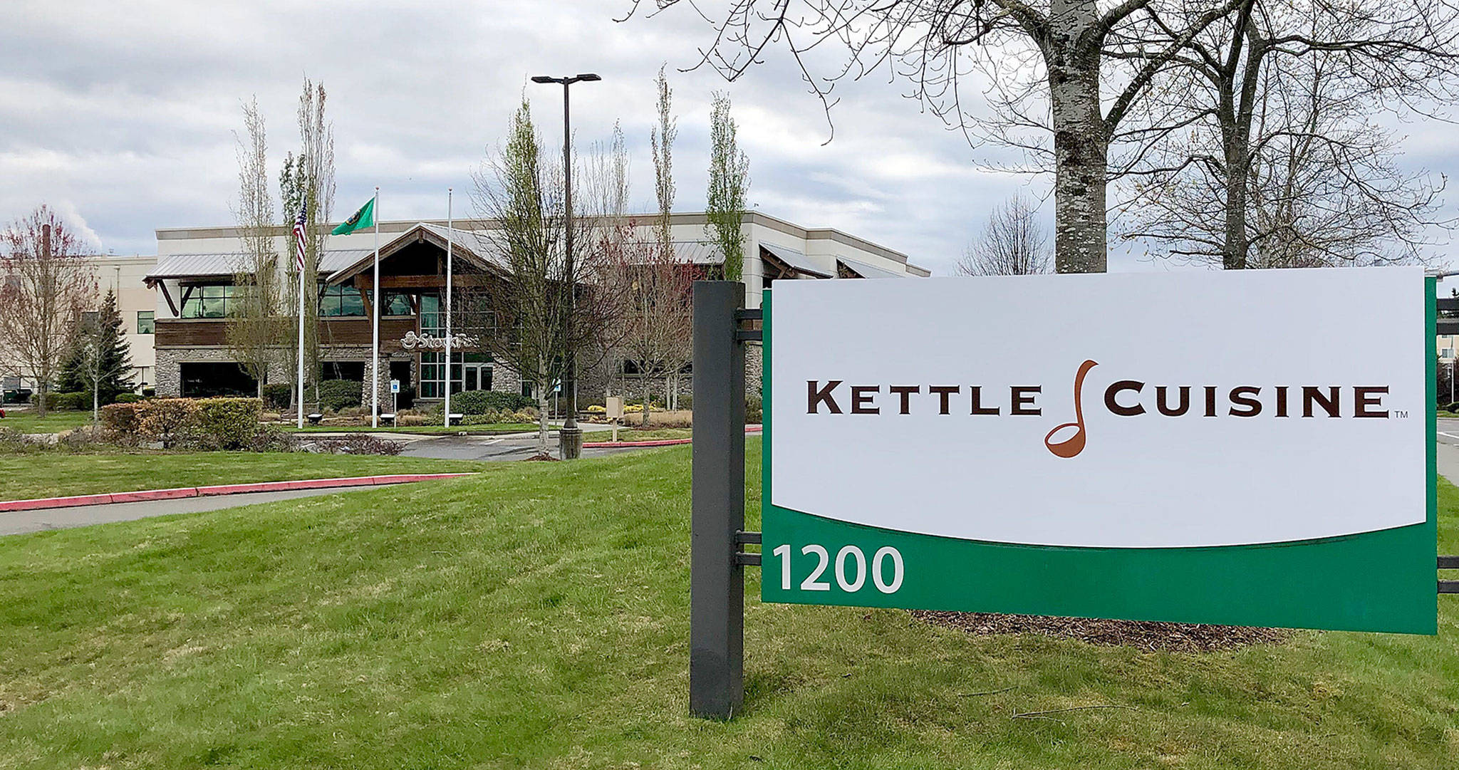 A new sign reflects new ownership, by Kettle Cuisine, at the former StockPot Soup plant in south Everett. (Janice Podsada / The Herald)
