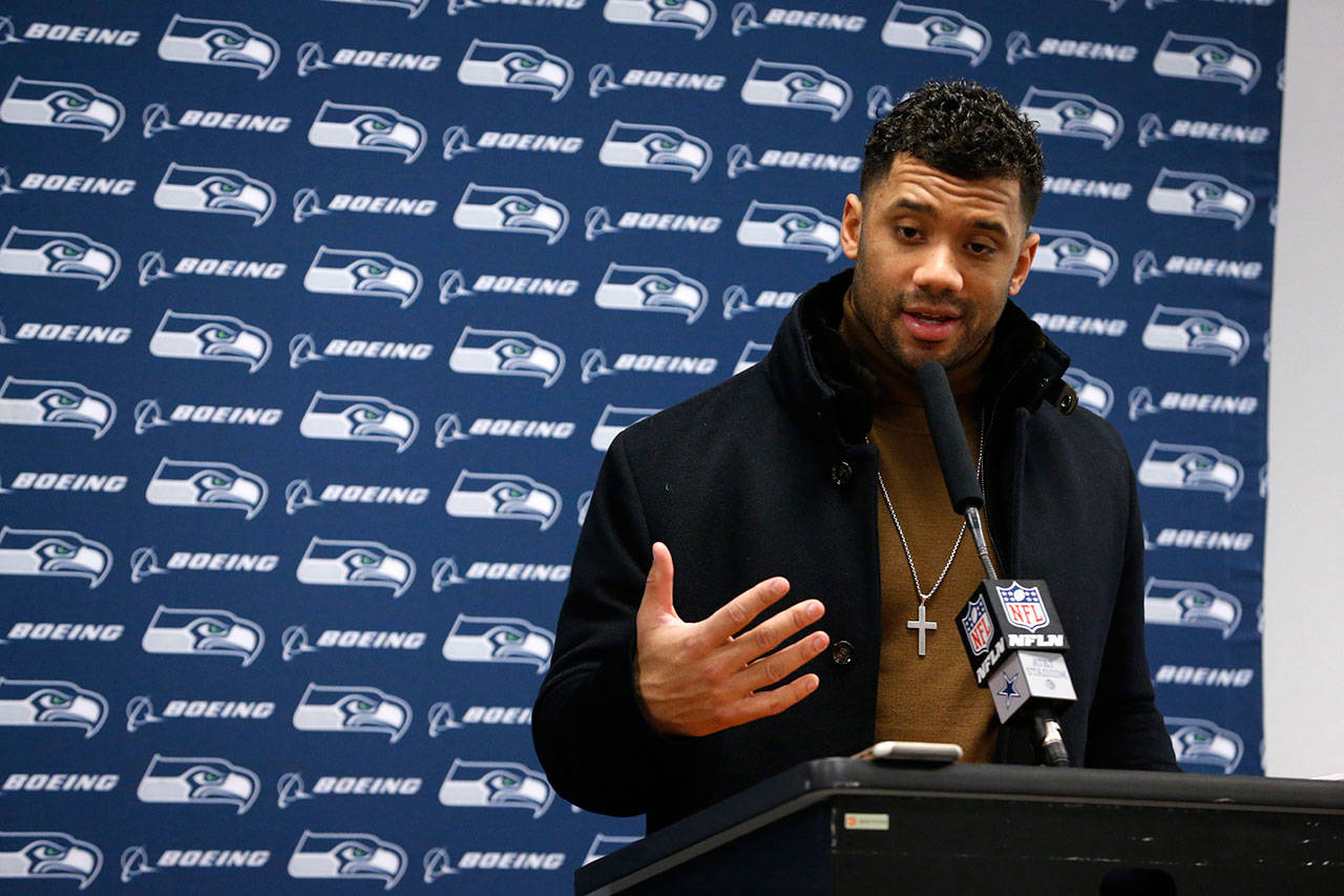 Seattle Seahawks quarterback Russell Wilson responds to questions during a news conference after the Seahawks' 24-22 loss to the Dallas Cowboys in an NFC playoff game on Jan. 5, 2019. (AP Photo/Michael Ainsworth)
