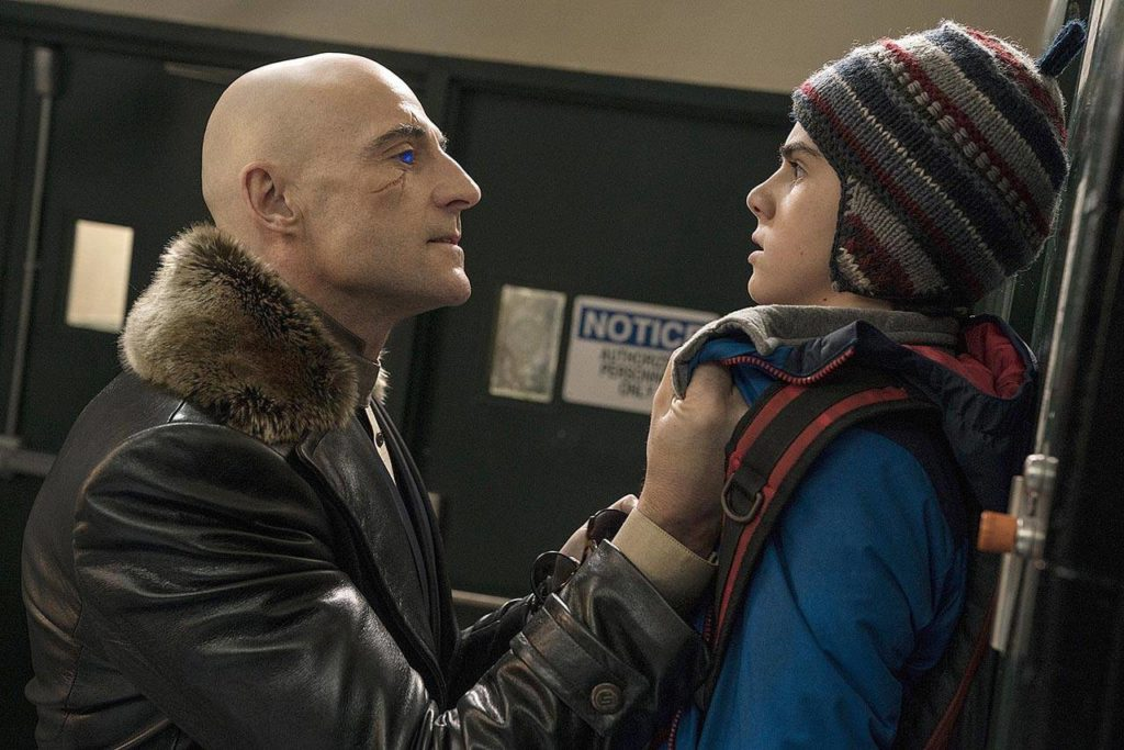 """Mark Strong (left) plays the evil Dr. Sivana, here menacing Freddy (Jack Dylan Grazer), in """"Shazam!"""" (Warner Bros. Pictures)"""