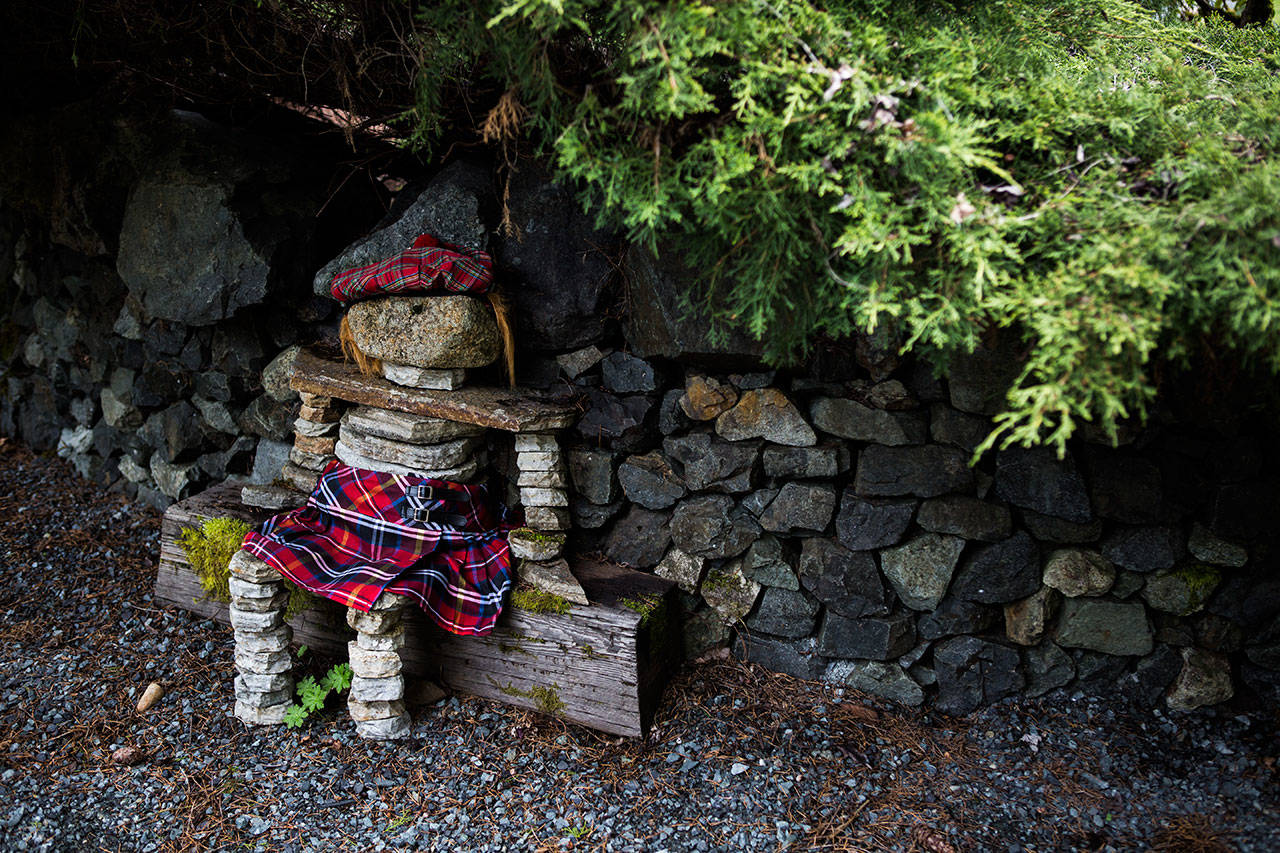 The wall builders made a rock figurine that the homeowners dress in a Scottish outfit, except during Seahawks season. (Olivia Vanni / The Herald)