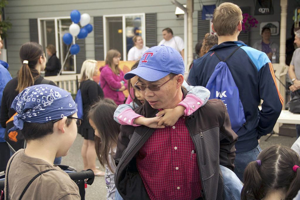 """Binh Nguyen, carrying his daughter Elizabeth Nguyen, at the """"Walk for Hope"""" fundraiser hosted by the Everett Gospel Mission. (Courtesy of Aaron Hoy)"""
