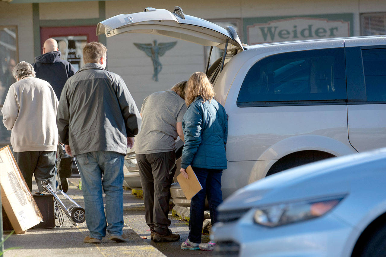 Federal agents serve a search warrant at Certified Medical Supply Inc., 603 E. Eighth St., in Port Angeles on Tuesday morning. (Jesse Major / Peninsula Daily News)