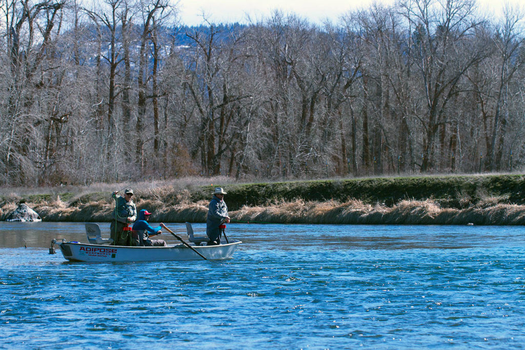 Paul Tetzlaff of Marysville and Les Bouck of Everett (both standing) drift flies along the upper Yakima River looking for trout. (Mike Benbow photo)
