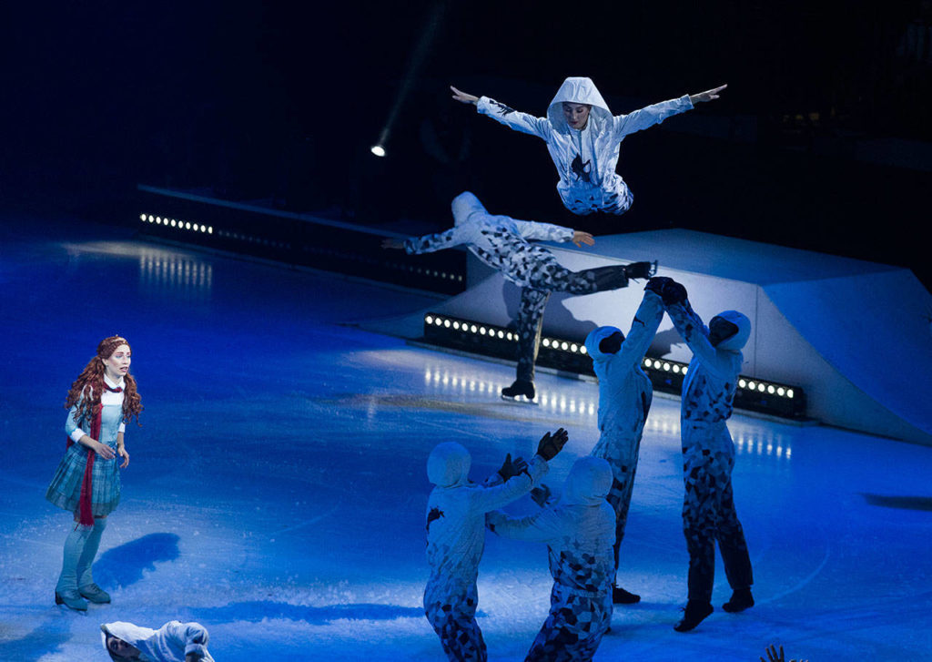 Silja Dos Reis, as Crystal, watches as acrobats fly through the air and skate around her. (Andy Bronson / The Herald)