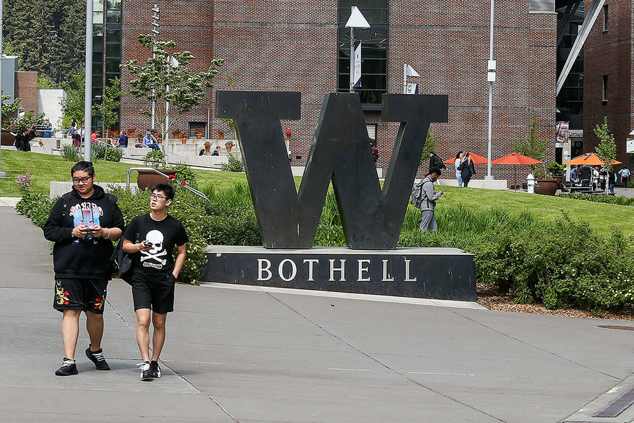 Students walk to classes at the UW Bothell campus on May 5, 2018 in Bothell, Wash. (Andy Bronson / The Herald)