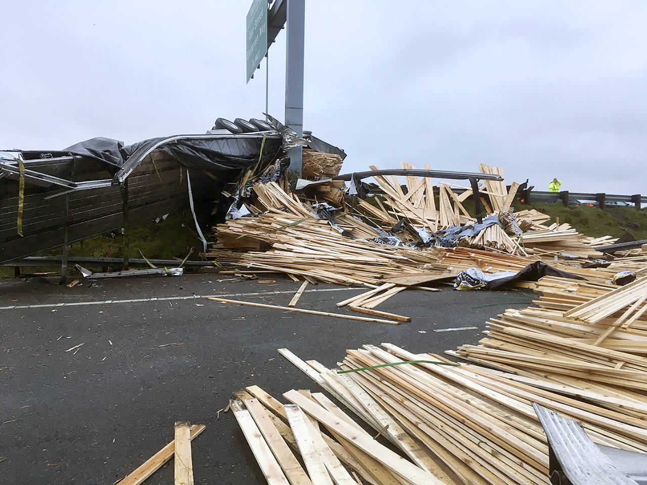 A truck lost a load of lumber after overturning on southbound I-5 near Pacific St. in Everett on Friday morning. (Sue Misao / The Herald)