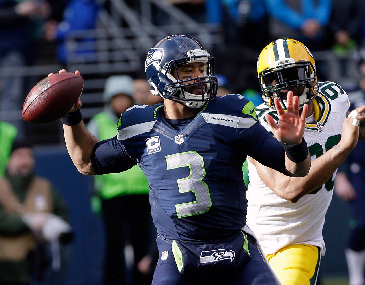 Seattle Seahawks quarterback Russell Wilson is now the highest-paid player in the NFL. (AP Photo/David J. Phillip)