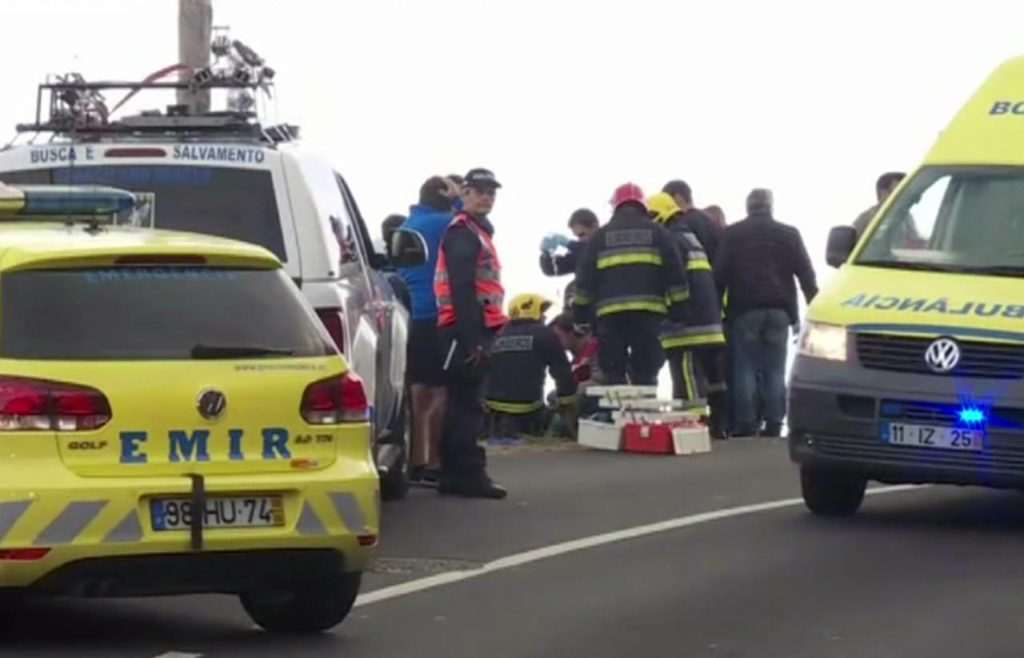 In this image from video, emergency services attend to injured at the scene after a tour bus crashed at Canico, on Portugal's Madeira Island, on Wednesday. (TVI via AP)