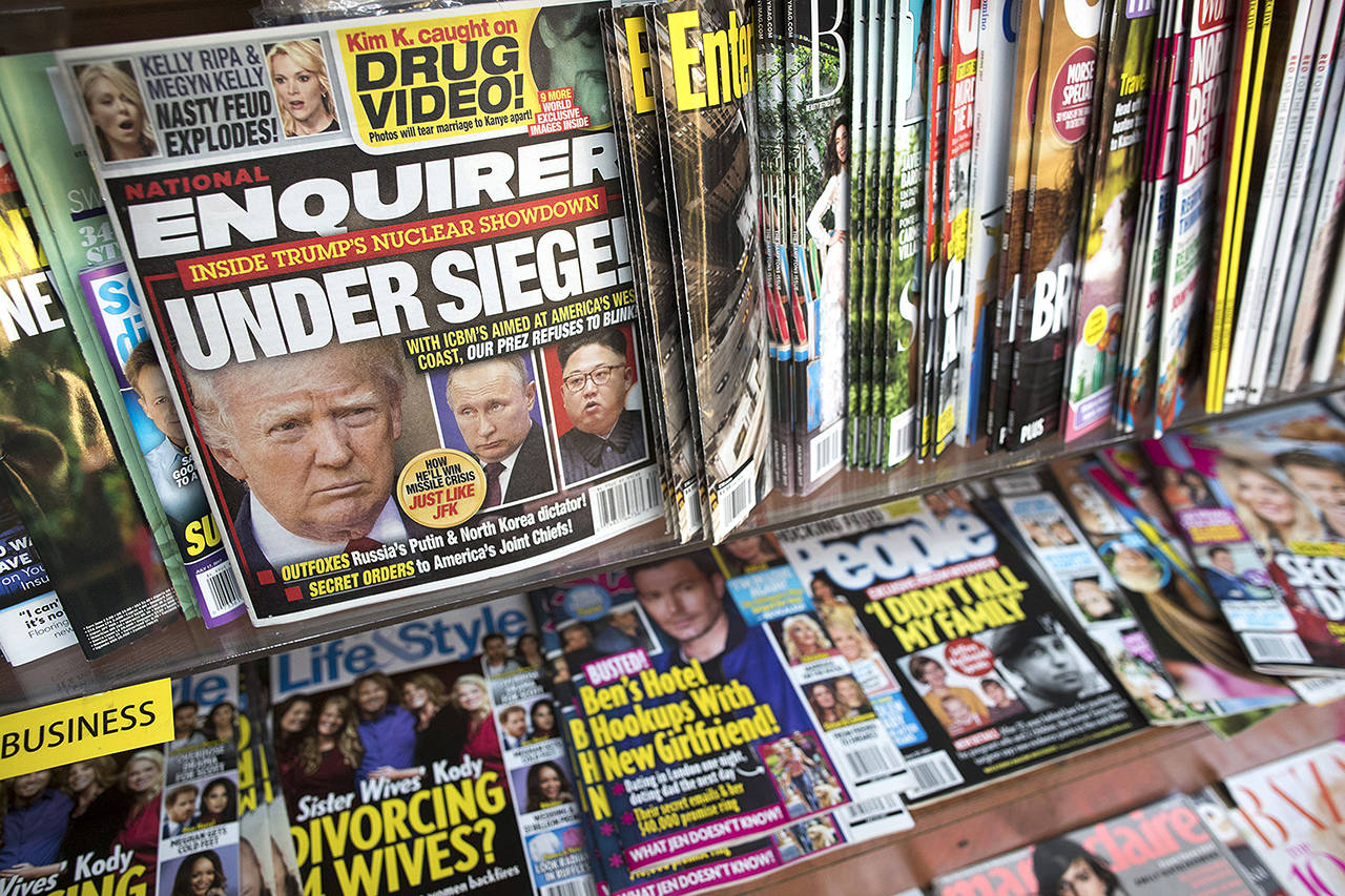 An issue of the National Enquirer featuring President Donald Trump on its cover isdisplayed on a newsstand in New York on July 12, 2017. (AP Photo/Mary Altaffer, File)