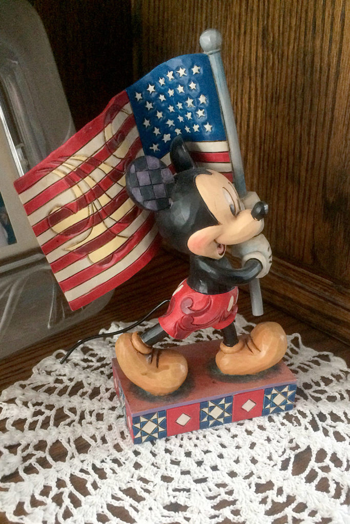 A flag-waving Mickey Mouse figurine is part of Cheryl Olsen's star-spangled collection. (Evan Thompson / The Herald)