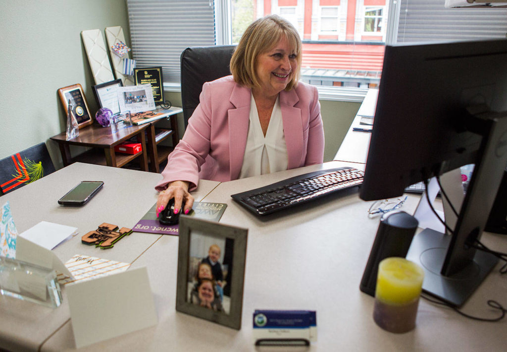 Barbara Tolbert smiles as she talks about some of the emails she receives from community members in her office on Wednesday, April 17, 2019 in Arlington, Wash. (Olivia Vanni / The Herald)