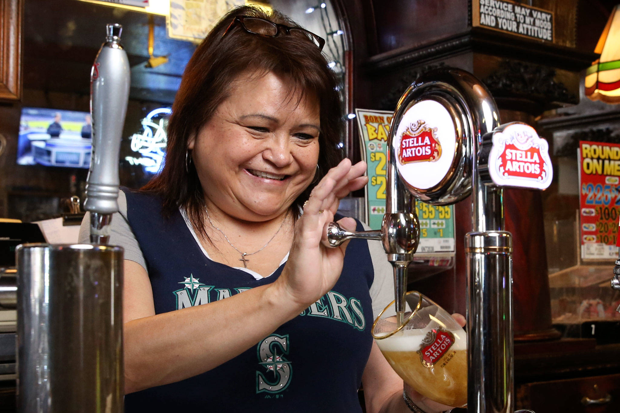 Denise McKenzie, 12-year bartender, pours a beer at Kuhnle's Tavern in Marysville. (Kevin Clark / The Herald)
