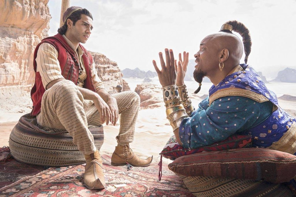 """Mena Massoud and Will Smith (in the Robin Williams role) in a live-action remake of """"Aladdin,"""" coming May 24. (Walt Disney Pictures)"""