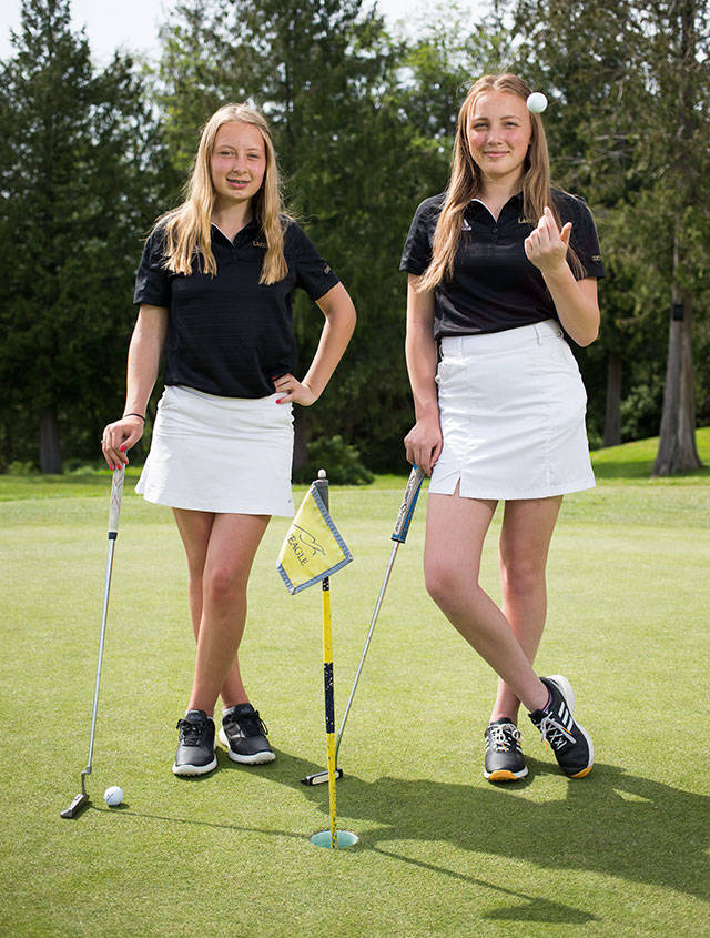Lakewood freshmen Mandy Harrison, left, and Malia Schroeder have both hit a hole-in-one this season for the Cougars. Shot on on Thursday, May 9, 2019 in Arlington, Wash. (Andy Bronson / The Herald)