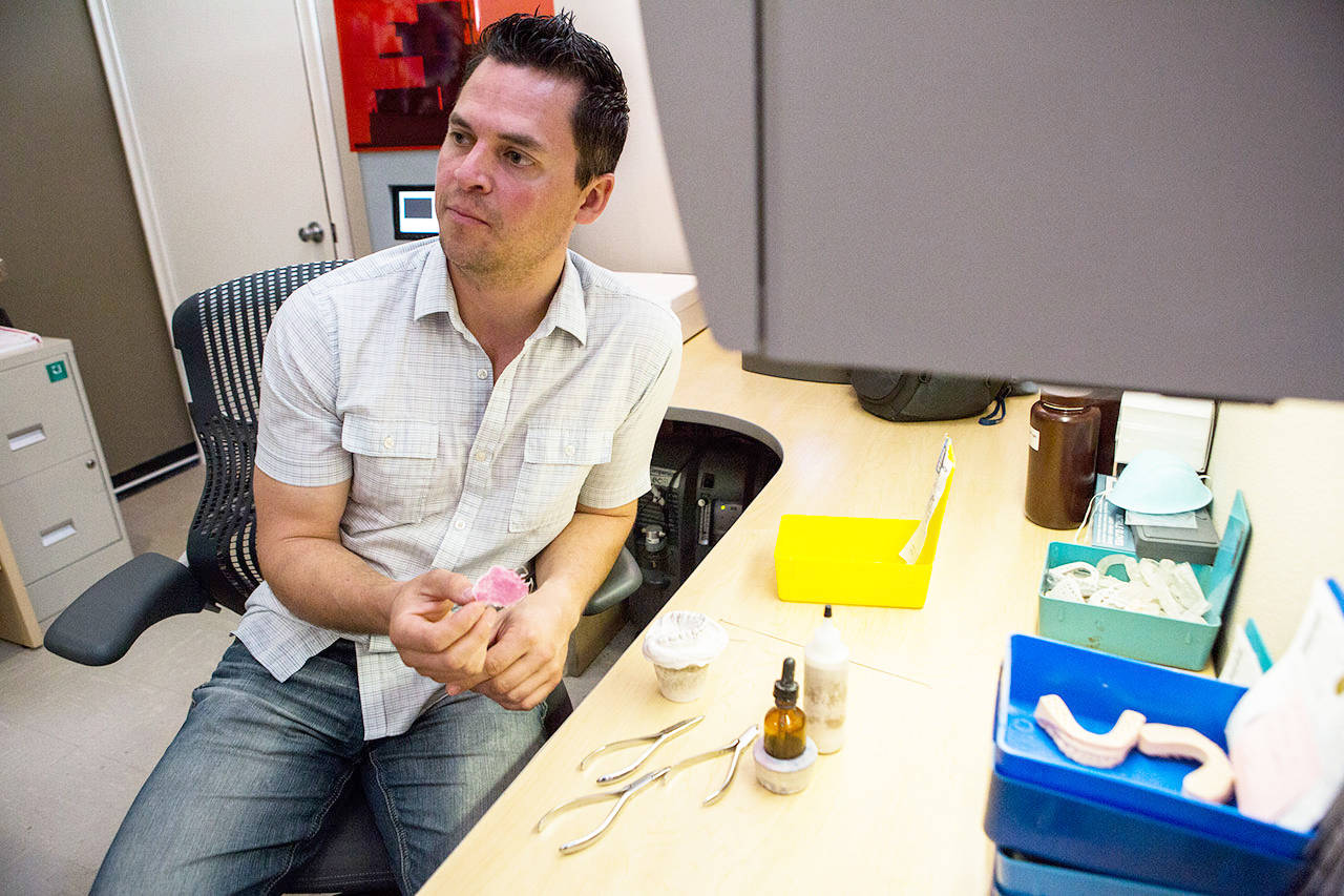 Jim Beierle talks about how they repair and fill retainers at Valley Orthodontic Laboratory in Snohomish. (Olivia Vanni / The Herald)