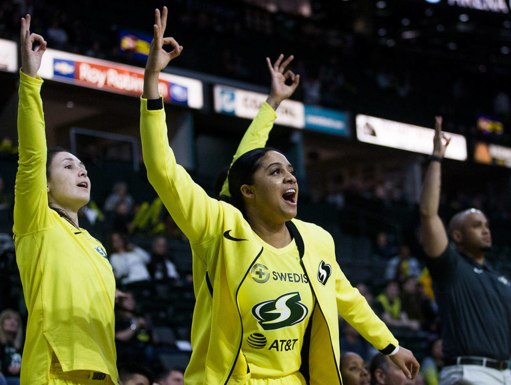Seattle's Recee' Caldwell celebrates on the bench after a Storm teammate made a 3-pointer during a preseason game against Phoenix on Wednesday at Angel of the Winds Arena in Everett. (Olivia Vanni / The Herald)