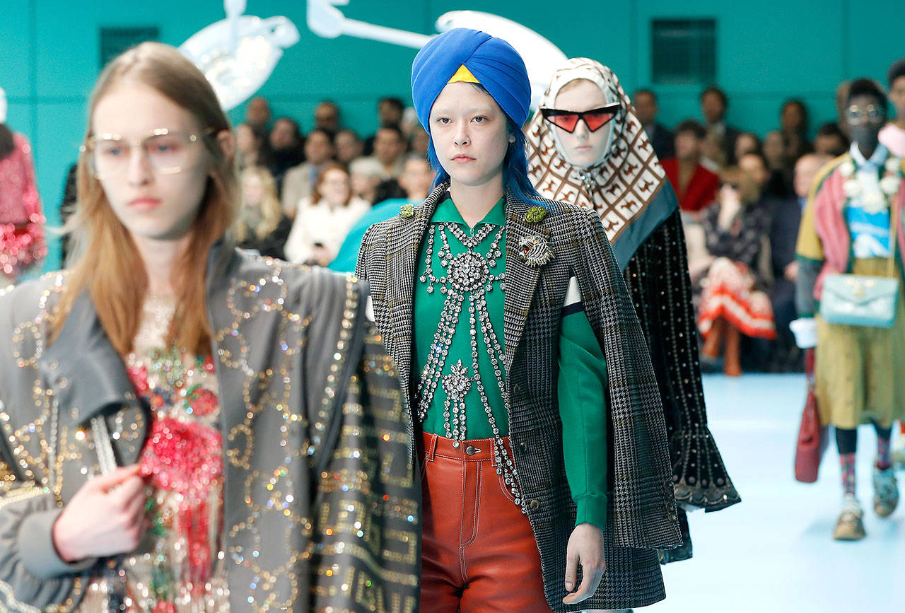 Models display items from Gucci's women's Fall/Winter 2018-2019 collection, presented during the Milan Fashion Week, in Milan, Italy, on Feb. 21. The top civil rights organization for Sikhs in the United States says Nordstrom has apologized to the community for selling an $800 turban they found offensive, but they are still waiting to hear from the Gucci brand that designed it. (AP Photo/Antonio Calanni, File)