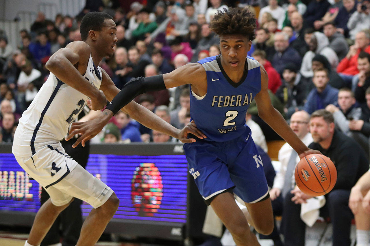 Federal Way's Jaden McDaniels (right) in action against the Ranney School during a game at the Hoophall Classic on January 21, 2019, in Springfield, Ma. (AP Photo/Gregory Payan)