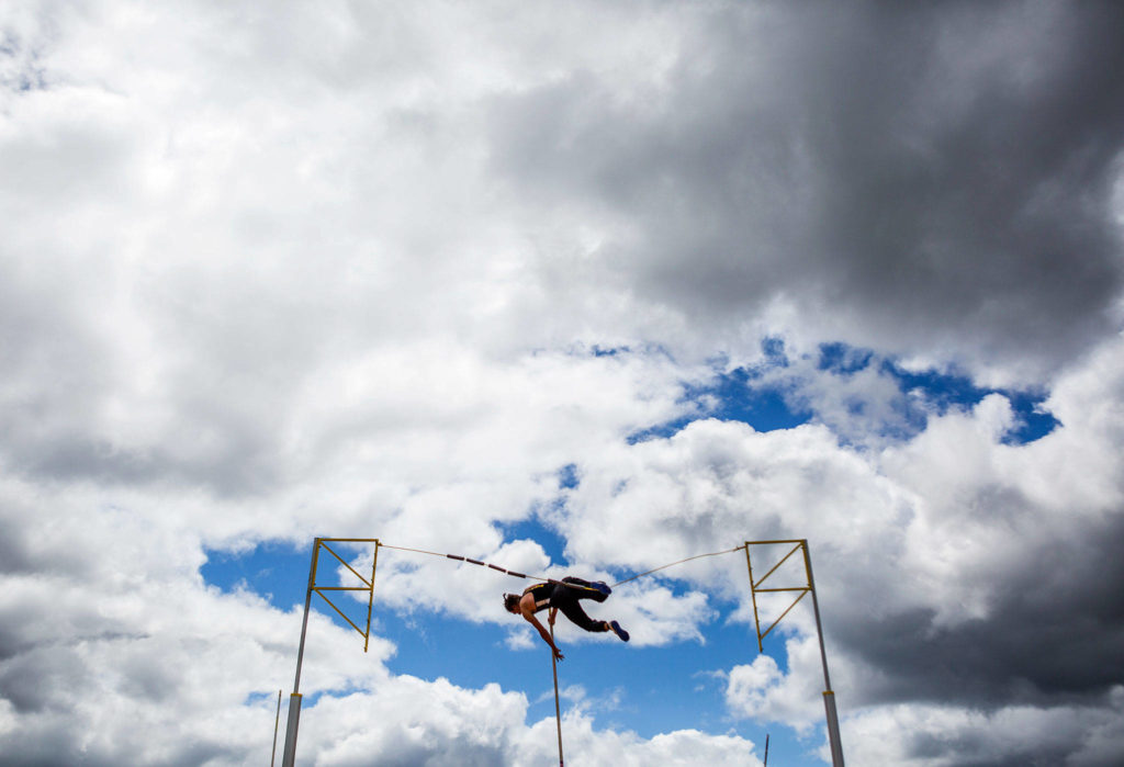A pole vaulter practices before the start of the 3A boys pole vault final during the second day of competition at the 4A/3A/2A State Track Field Championships on Friday at Mount Tahoma High School in Tacoma. (Olivia Vanni / The Herald)