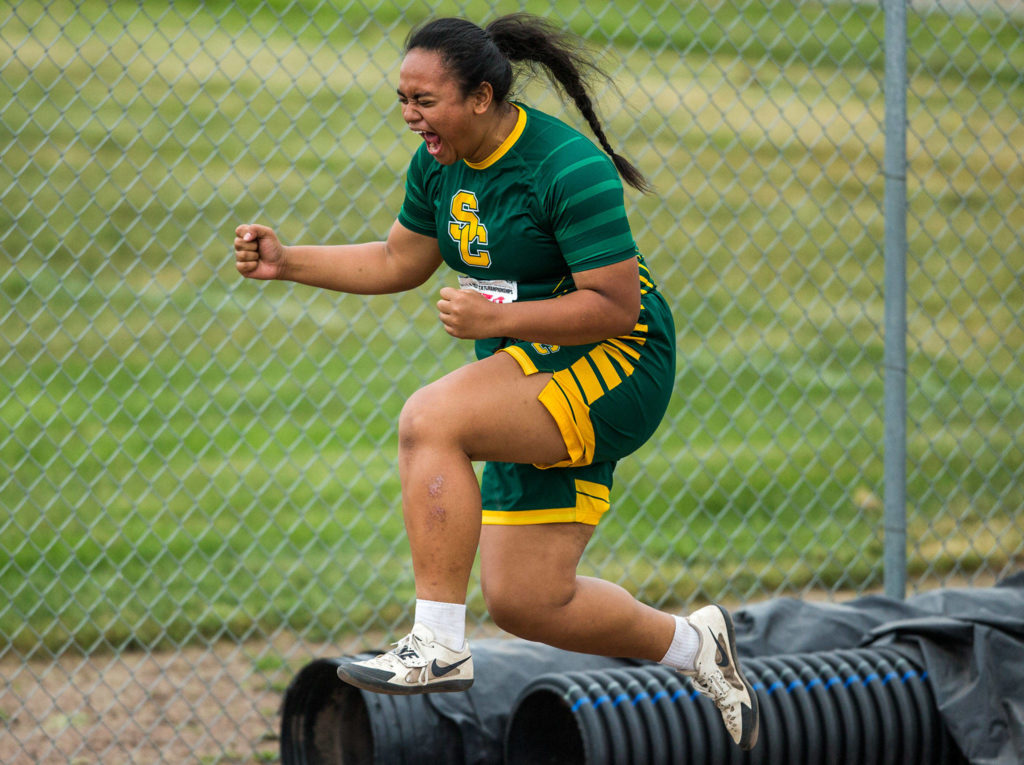Shorecrest's Kiana Lino jumps in the air after achieving a personal best in the shot put Friday during the second day of competition at the 4A/3A/2A State Track Field Championships at Mount Tahoma High School in Tacoma. (Olivia Vanni / The Herald)