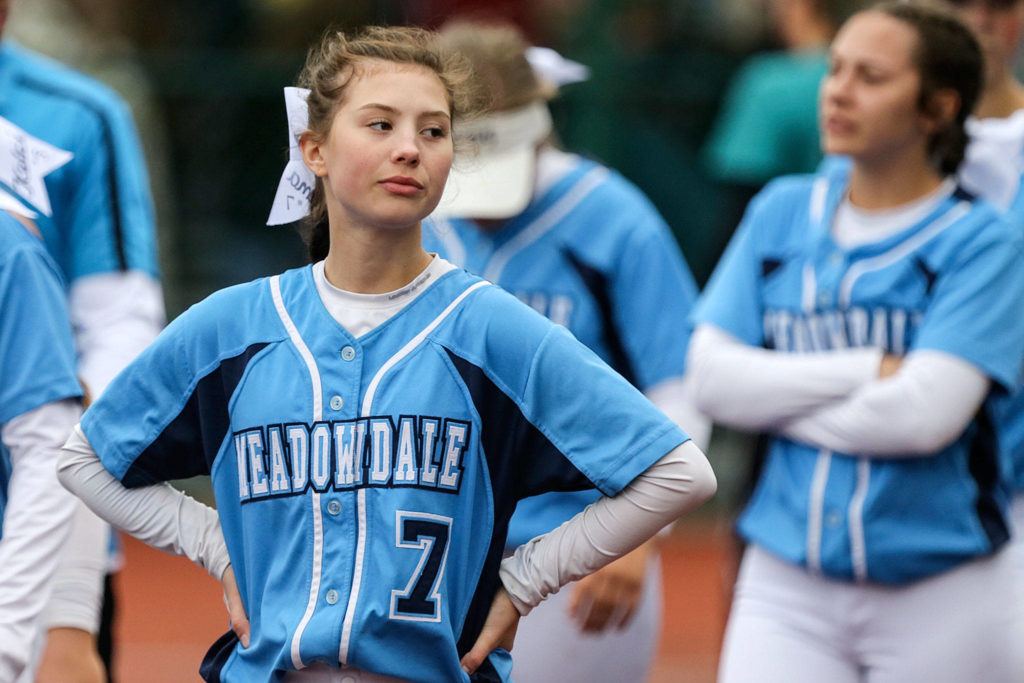 Meadowdale's Emma Meyer walks off the field dejected with her team after loosing to Bonney Lake Friday afternoon during the 3A Softball State Championship at the Regional Athletic Complex in Lacey. (Kevin Clark / The Herald)
